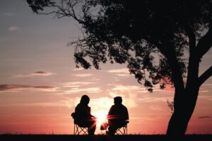 sunset couple talking